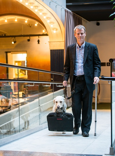 Magnus Berglund with his service dog, Dixie