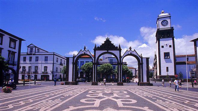 Ponta Delgada square with decorative cobblestones and heritage ceremonial gateway