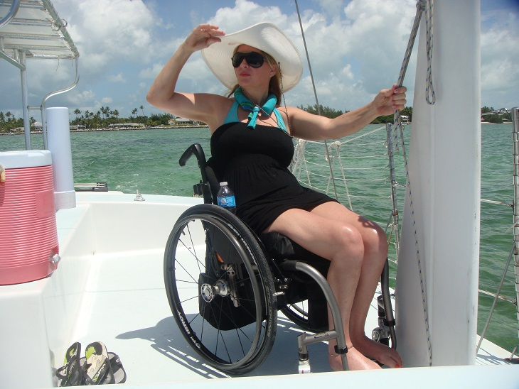 Woman in a wheelchair enjoying a boat trip