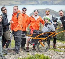 Image of Joelette with group on mountain trek