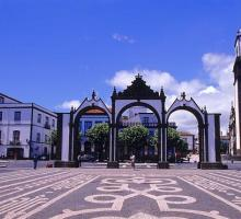 Ponta Delgada square with decorative cobblestones and heritage ceremonial gateway