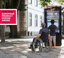 TOMI information screen with wheelchair user and young boy
