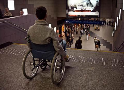 Metro4All, photo of wheelchair user at top of metro station steps