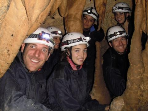 Image of 5 cavers in a cave