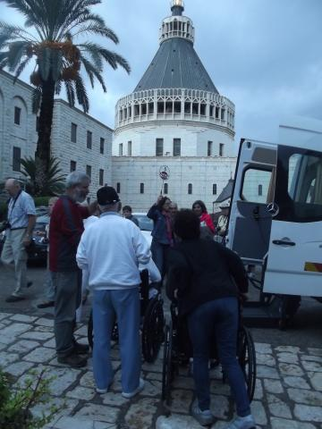 Image of visitors and wheelchair accessible transport