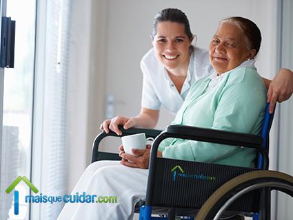 Image of elderly lady in wheelchair and carer